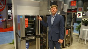 Christian Kuh of Moffat shows a full size convection oven. The oven can fit on a food truck.
