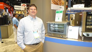 Zachary Heisler presents a new convection oven at the Nemco Food Equipment booth.