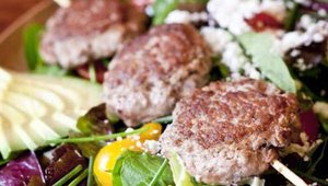 Salads and vegetables include the Farmers Market Salad featuring mini burger patties and seasonal offerings such as Sweet Baby Broccoli with Lemon Garlic, Chili Flakes and Parmigiano Reggiano.