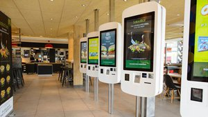 McDonald's tests cash-accepting self-order kiosks; will retrofits be needed?